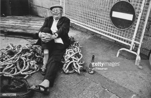 A contented man on the quayside in northern France circa 1970