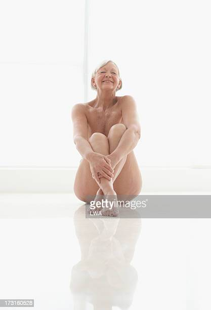 Contented nude mature woman