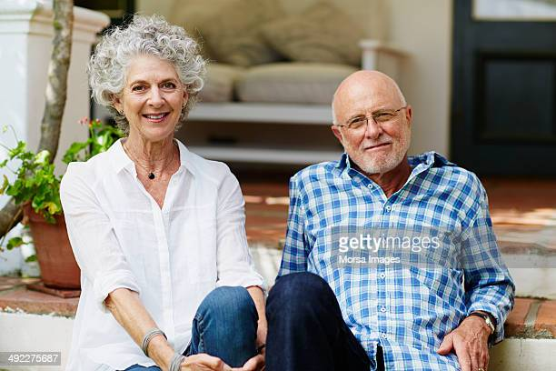 Contented senior couple sitting at porch