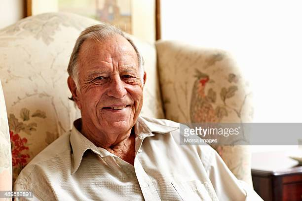 contented senior man in nursing home - 80 89 years stock pictures, royalty-free photos & images