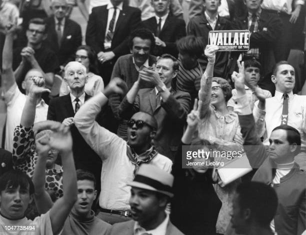 A contentious crowd of supporters and protestors gather at a political rally for US presidential candidate George Wallace in Minneapolis Minnesota...