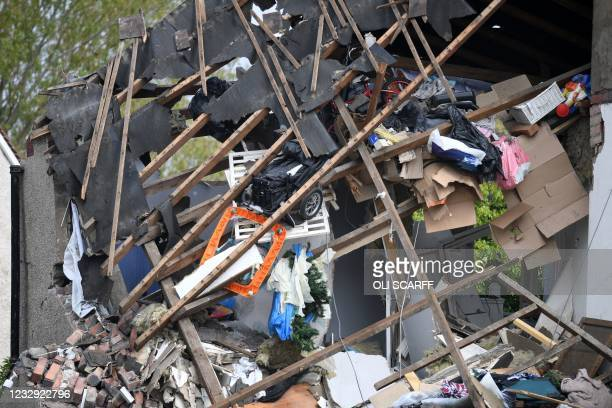 Contents inside the remains of a house are seen in a street in the town of Heysham in north-west England, the site of an overnight gas explosion on...