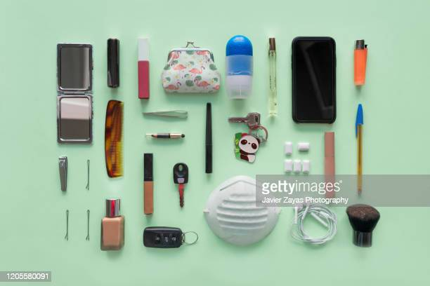 contents of a woman's bag - flat lay stock pictures, royalty-free photos & images