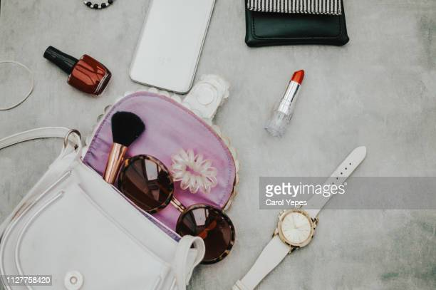 contents of woman bag 2 - clutch bag stock pictures, royalty-free photos & images