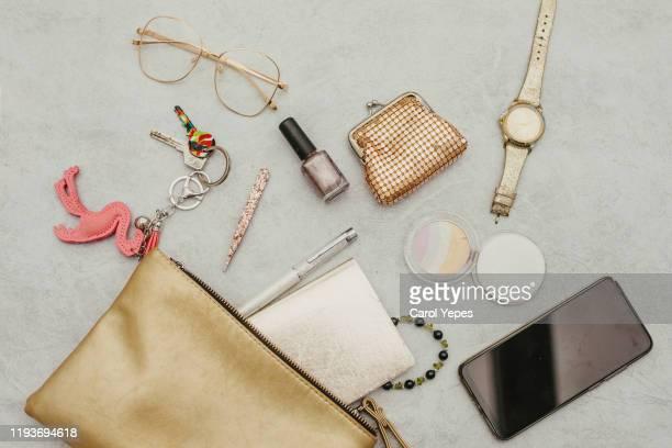 contents of woman bag 2 - pochette borsetta foto e immagini stock