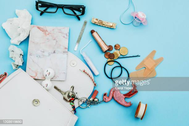 contents of woman mother bag - clutch bag stock pictures, royalty-free photos & images