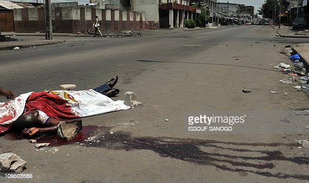 CONTENTThe body of a civilian who was killed on February 21 2011 lies on a street of Treichville in Abidjan in clashes between forces loyal to...