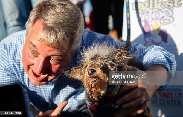 Contest judge Kerry Sanders points to Scamp The Tramp shortly after being announced as the winner of the World's Ugliest Dog Competition in Petaluma...