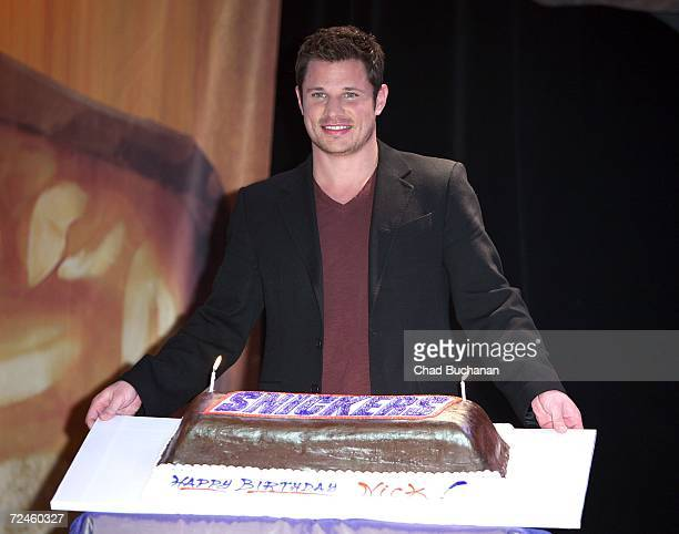 Contest judge Nick Lachey poses with his birthday cake at the finals of Snickers Satisfaction SingOff at the House of Blues on November 8 2006 in...