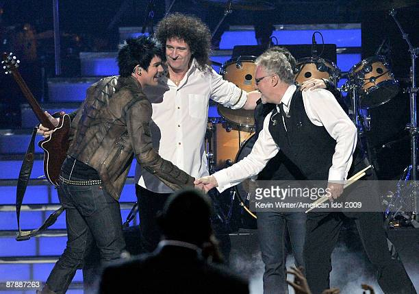 Contestant Adam Lambert musicians Brian May and Roger Taylor of Queen perform onstage during the American Idol Season 8 Grand Finale held at Nokia...