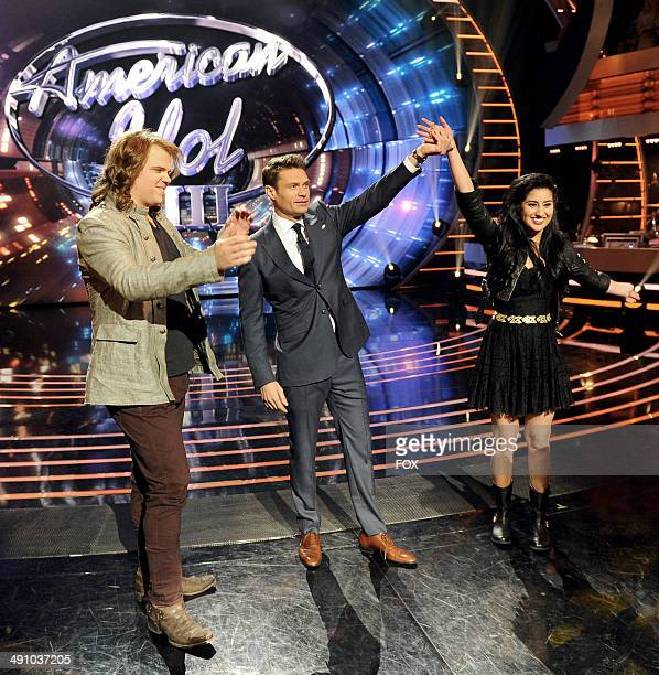 Contestant Caleb Johnson host Ryan Seacrest and coin toss winner Jena Irene onstage at FOX's American Idol XIII Top 3 to 2 Live Performance Show on...