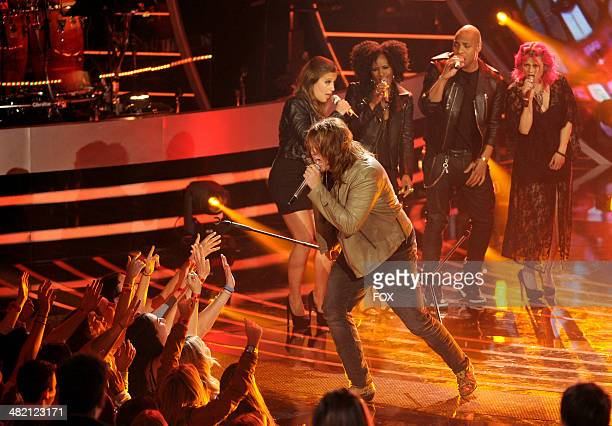 Contestant Caleb Johnson performs onstage at FOX's 'American Idol XIII' Top 8 Live Performance Show on April 2 2014 in Hollywood California