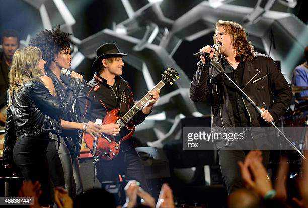 Contestant Caleb Johnson performs onstage at FOX's 'American Idol XIII' Top 6 Live Performance Show on April 23 2014 in Hollywood California