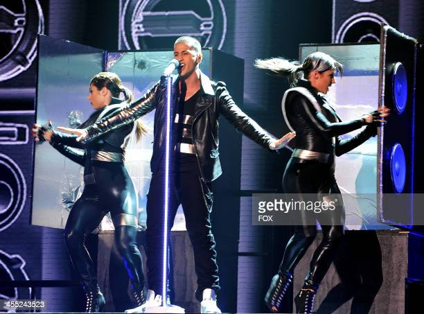 Contestant Carlito Olivero perform onstage on FOX's 'The X Factor' Season 3 Top 4 Live Performance Show on December 11 2013 in Hollywood California