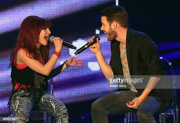 Contestant Carlotta and Vocal Coach Johannes Strate perform at the secondseason finale for the German version of 'The Voice Kids' singing competition...