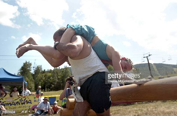 A contestant carries his partner during the 2nd annual North American Wife Carrying Championships July 21 2001 in Newry ME The events a Finnish...