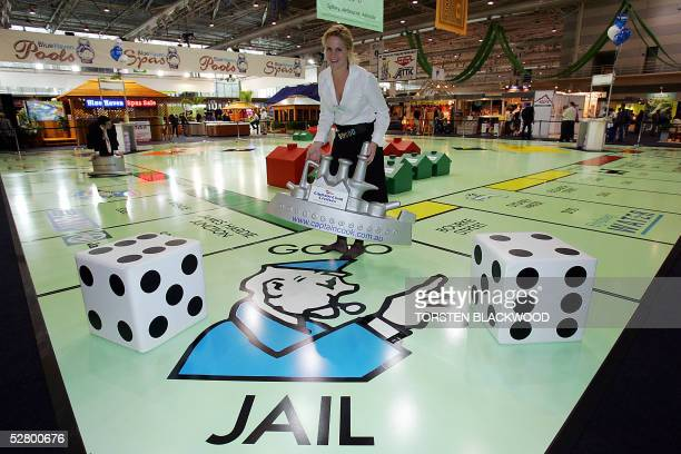 Contestant Christina Brown plays the first game on the world's largest Monopoly board, occupying an enormous 440 square metres, at the Sydney...