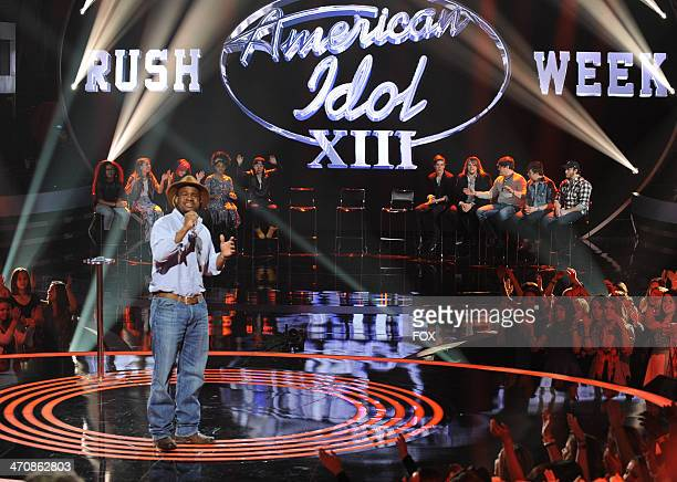 Contestant CJ Harris is seen performing onstage for a spot in the top 13 on FOX's 'American Idol' Season 13 Top 20 to 13 Live Elimination Show on...