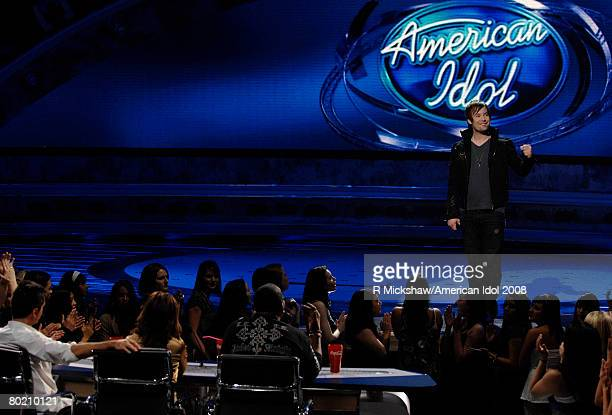 ACCESS*** Contestant David Cook performs Eleanor Rigby by The Beatles live on American Idol March 11 2008 in Los Angeles California The top 12...