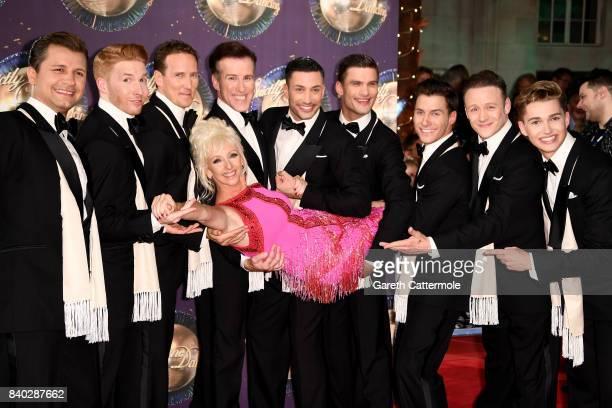 Contestant Debbie McGee is held by male dancers Pasha Kovalev Neil Jones Brendan Cole Anton du Beke Giovanni Pernice Aljaz Skorjanec Gorka Marquez...
