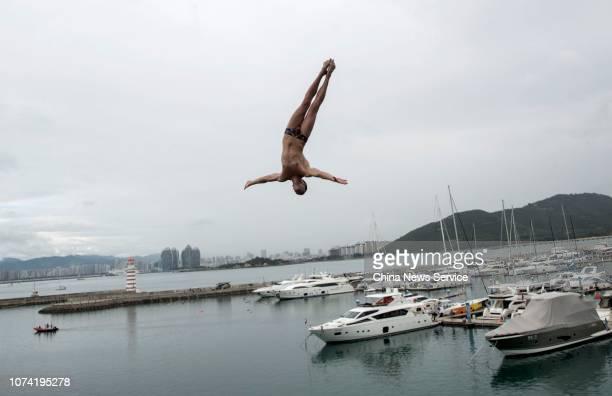 A contestant dives during the 2018 Sanya International Extreme Diving Master at Sanya Serenity Marina on November 28 2018 in Sanya Hainan Province of...