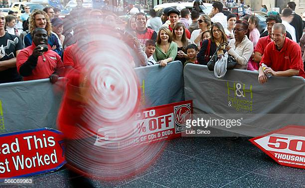 A contestant entertains a crowd during a sign spinning contest along Hollywood Blvd on Tuesday Dec 30 The contest sponsored by Aarow Advertising...