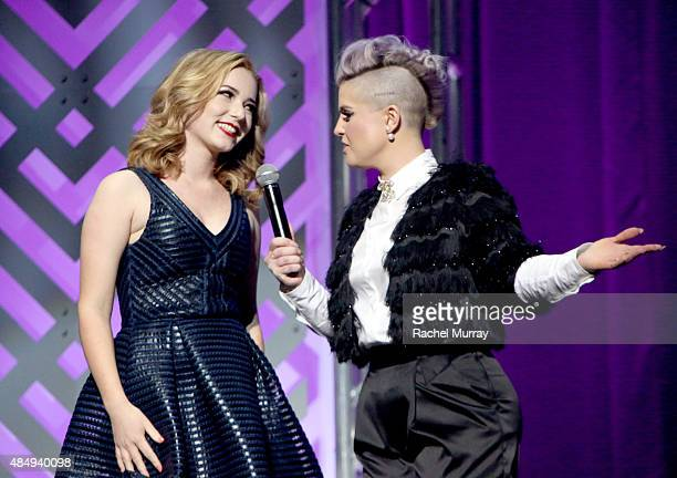 Contestant Erin Timony and host Kelly Osbourne speak on stage at the 4th Annual NYX FACE Awards at Club Nokia on August 22 2015 in Los Angeles...