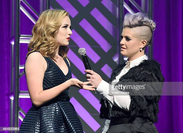 Contestant Erin Timony and host Kelly Osbourne speak onstage during the 4th Annual NYX FACE Awards at Club Nokia on August 22 2015 in Los Angeles...