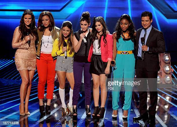 Contestant Fifth Harmony and hosts Khloe Kardashian and Mario Lopez onstage at FOX's 'The X Factor' Season 2 Top 6 Live Performance Show on December...