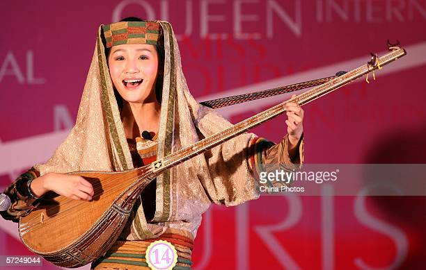 Contestant Fu Ling performs during a talent show of the China Competition of 2006 Miss Tourism Queen International on April 4 in ancient Xitang...