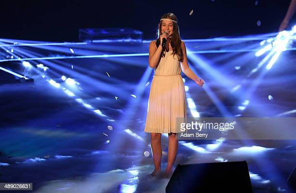 Contestant Hanna performs at the secondseason finale for the German version of 'The Voice Kids' singing competition on May 9 2014 in Berlin Germany...