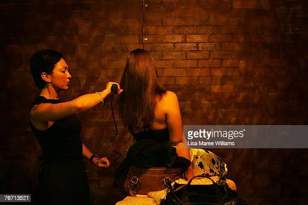 A contestant has her hair done backstage during the Miss Earth Australia contest at the Enmore Theatre September 13 2007 in Sydney Australia...