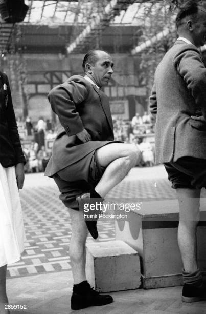 A contestant in a Butlin's knobbly knees contest Original Publication Picture Post 6589 Picture Post Visits a Holiday Camp pub 1953