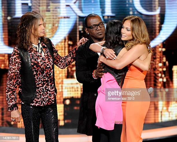 Contestant Jessica Sanchez is saved by judges Randy Jackson Steven Tyler and Jennifer Lopez onstage at FOX's American Idol Season 11 Top 7 To 6 Live...