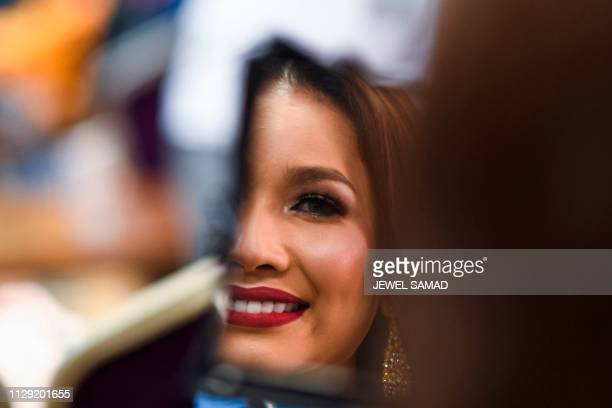 Contestant Larra Jassinta of Malaysia prepares backstage during the Miss International Queen 2019 transgender beauty pageant in Pattaya on March 8...