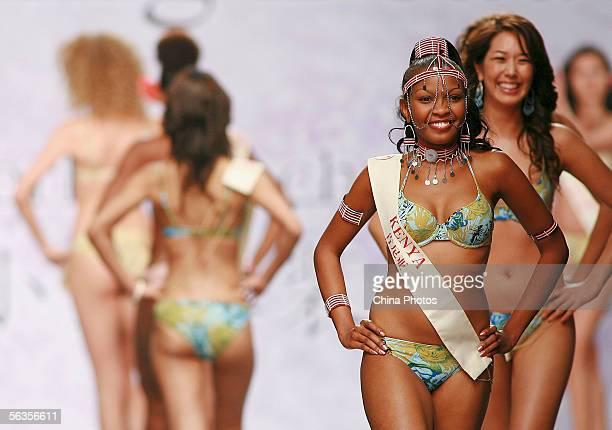 Contestant of the 55th Miss World 2005 Cecilia Murugi Mwangi of Kenya performs during the Beachwear Final at the Sheraton Sanya Resort on December 6...
