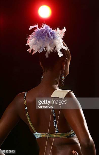Contestant of the 55th Miss World 2005 Praise Juliet Akankwatsa of Uganda competes during the Beachwear Final at the Sheraton Sanya Resort on...
