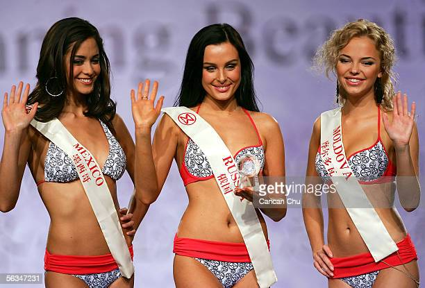 Contestant of the 55th Miss World 2005 Yulia Ivanova of Russia celebrates with Dafne Molina Lona of Mexico and Irina Dolovova of Moldova after...