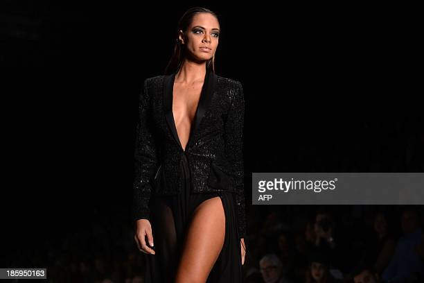 Contestant of the Miss Universe 2013 beauty pageant, Miss France 2013 Hinarani de Longeaux displays a creation by Lebanese designer Tony Ward during...