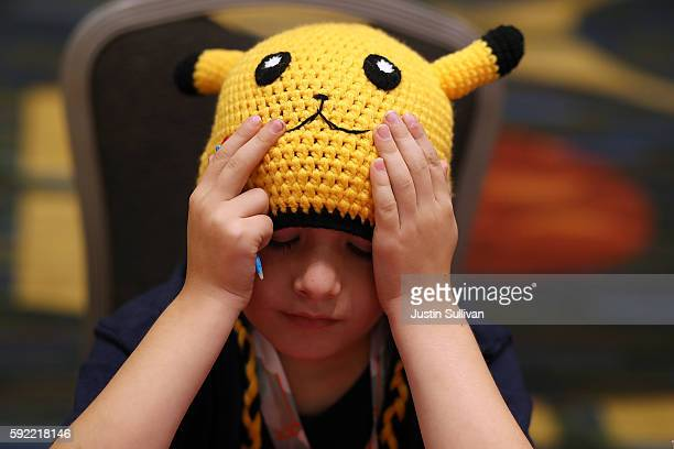 A contestant pauses as she competes during the 2016 Pokemon World Championships on August 19 2016 in San Francisco California Over 1600 contestants...