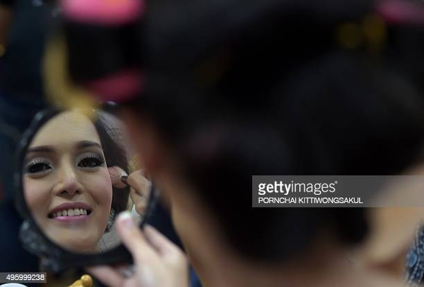 A contestant prepares backstage during the Miss International Queen 2015 beauty contest in Pattaya resort on November 6 2015 Twentyseven contestants...