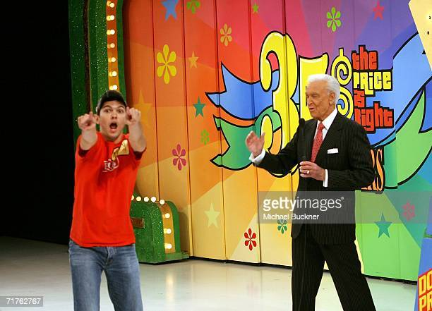 A contestant reacts after winning a new car alongside host Bob Barker at the taping of the 35th Season premiere of The Price Is Right at CBS...