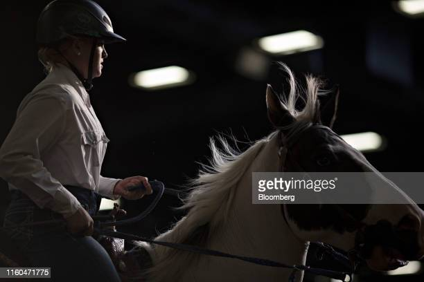A contestant rides a horse during a Future Farmers of America barrel racing event at the Iowa State Fair in Des Moines Iowa US on Thursday Aug 8 2019...