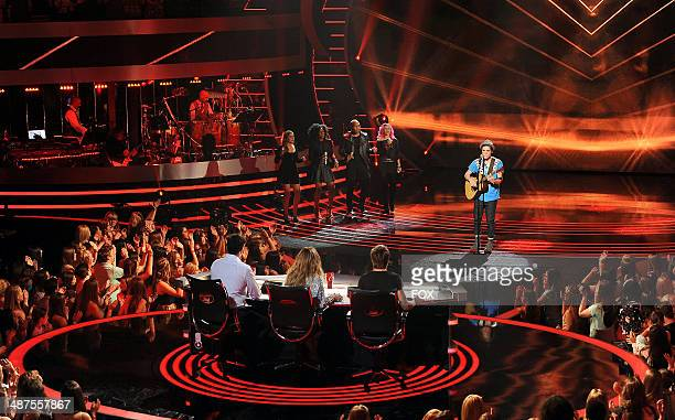 Contestant Sam Woolf performs onstage at FOX's 'American Idol XIII' Top 5 Live Performance Show on April 30 2014 in Hollywood California