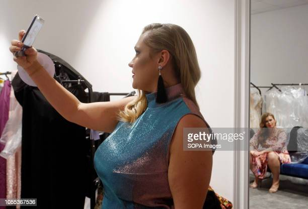 A contestant seen taking a selfie photo backstage during the Miss Ukraine Plus Size beauty pageant in Kiev 22 female contestants competed in the...