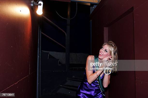 Contestant Snezana Peric adjusts her earring backstage during the title of Miss Earth Australia at the Enmore Theatre September 13 2007 in Sydney...