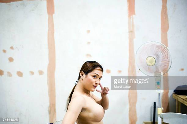 Contestant who goes by the stage name Bea Alonso prepares to take the stage for the Miss Gay Sandugo beauty pageant July 19 2006 in Tagbilaran...