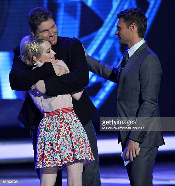 ACCESS*** Contestants Alexis Grace and Michael Sarver and host Ryan Seacrest are seen onstage during the live elimination show on American Idol March...