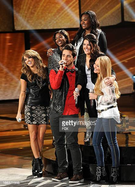 Contestants Angie Miller Amber Holcomb Lazaro Arbos Candice Glover Kree Harrison and Janelle Arthur perform onstage at FOX's American Idol Season 12...