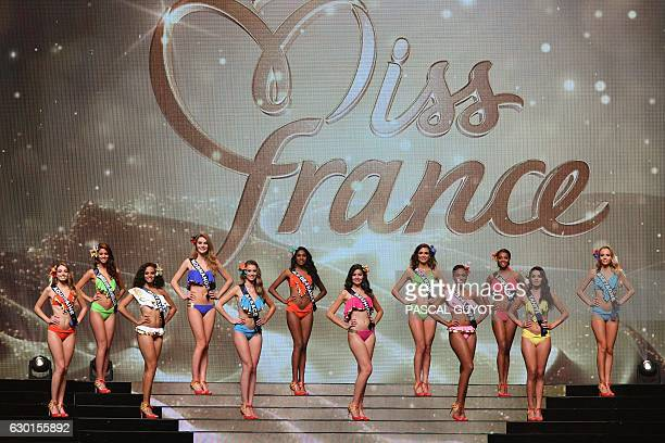 Contestants appear on stage in swimsuit during the Miss France 2017 beauty contest on December 17 2016 in Montpellier Third from left is Miss Guyane...
